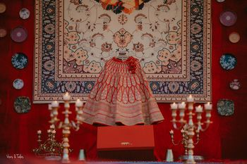 Red bridal lehenga on hanger