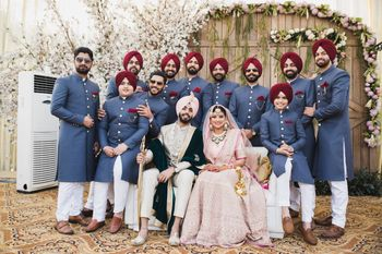 Sikh couple with coordinated groomsmen