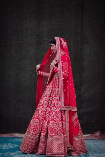 Photo of A bride in a red lehenga on her wedding day
