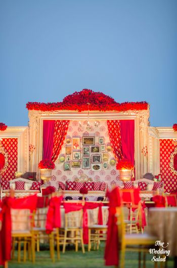 Photo of Unique wedding decor with red and gold theme