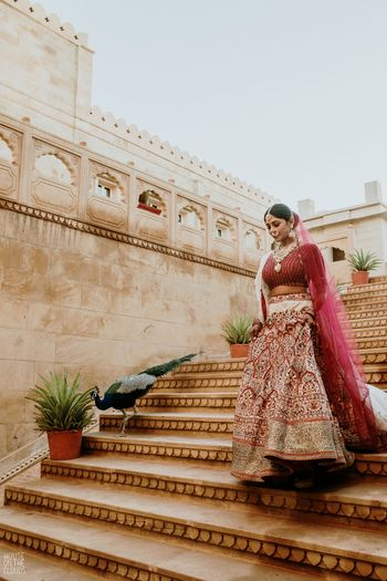 Candid shot of the bride walking down the stairs.