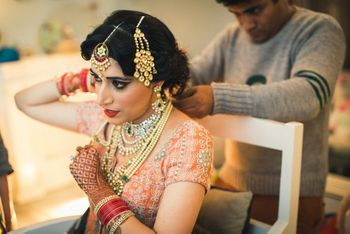 Peach Bride wearing Layered Gold Jewelry