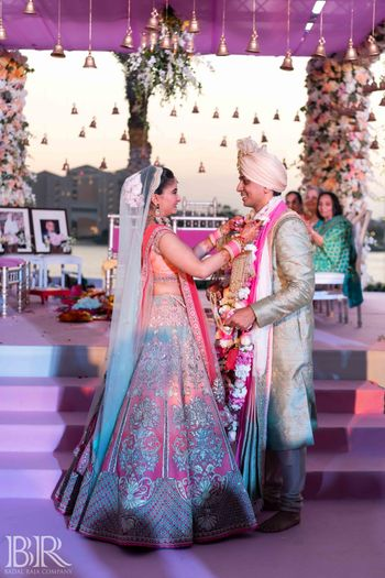 Photo of Jaimala shot with ombre pink lehenga