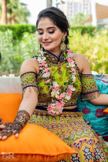 Photo of Mehendi outfit with green cold shoulder blouse