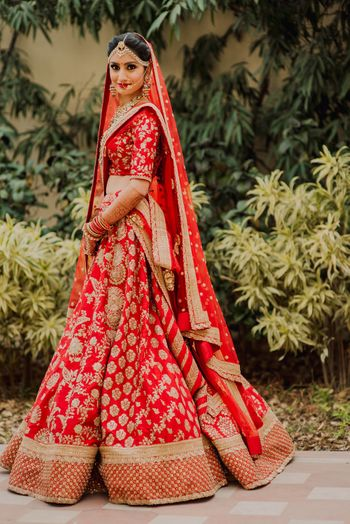 Photo of Red and gold bridal sabysachi lehenga with embroidery