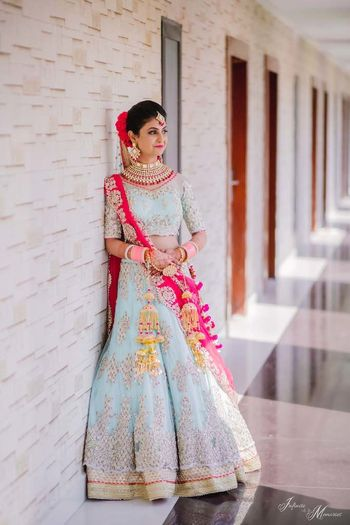 Photo of A bride in powder pink lehenga and baby pink chooda.