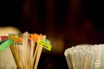 Photo of drink stirrers with sayings tagged on them