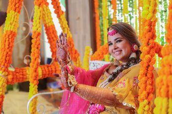 Photo of mehendi or haldi bridal portrait in yellow