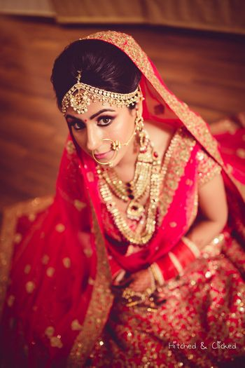 Photo of Bride in pink lehenga