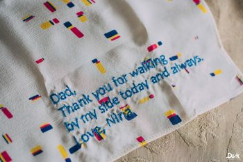 Photo of Embroidered message from bride to father on napkin