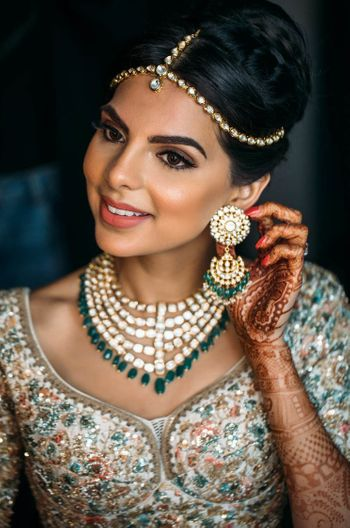 Polki bridal jewellery set with green beads and simple maangtikka
