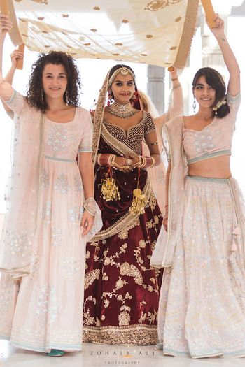 Photo of Unique bridal entry with bridesmaids holding phoolon ka chadar