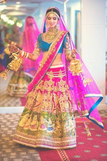 Kitsch hot pink bridal lehenga with cobalt blue blouse