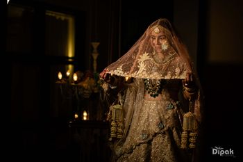 Photo of Bride holding her veil
