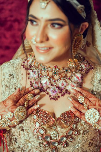 Bride wearing an enameled bridal choker with a rani haar.