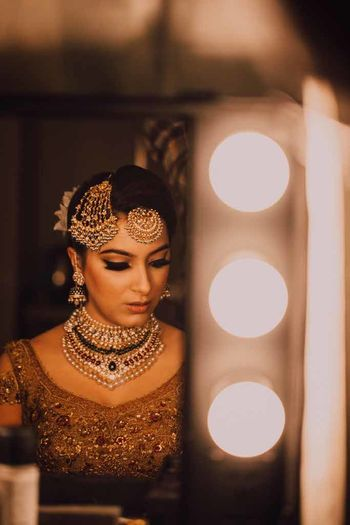 A bride in heavy jewellery