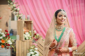 Photo of Green jewellery with peach lehenga