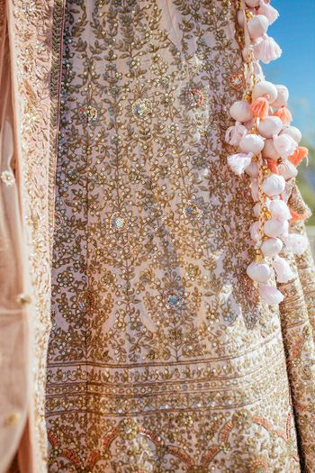Photo of Pretty light pink latkans with gold and pastel pink lehenga for wedding