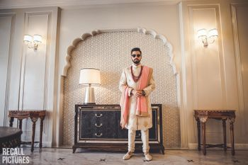 Unique groomwear idea with off white sherwani and sunnies