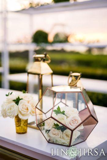 Pretty floral arrangement inside geometric orbs