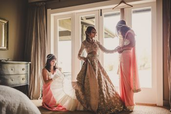 Indian bride getting ready in pastel lehenga