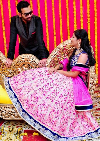 Photo of fuschia and cobalt blue lehenga. colorblock