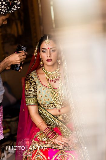 Photo of Mint and pink bridal lehenga