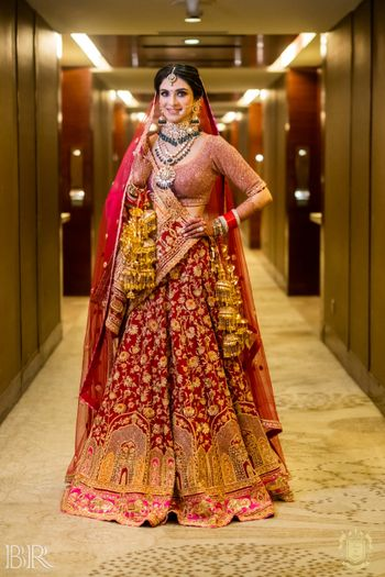 classic red bridal lehenga with unique gold embroidery