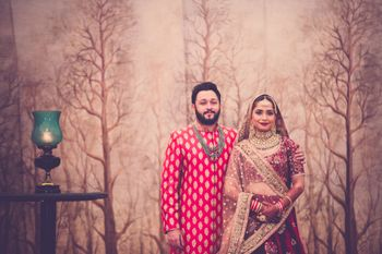 Photo of Red and maroon bride and groom