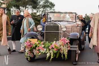 Grooms entry in a vintage car