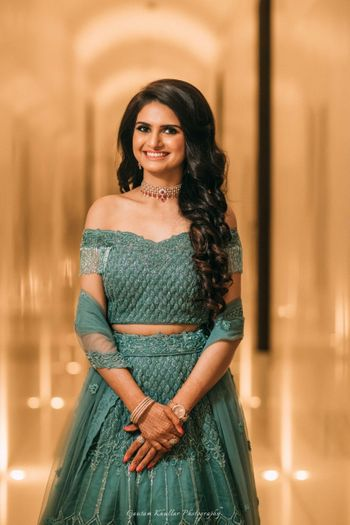 Photo of Off shoulder teal engagement lehenga
