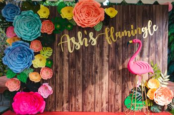 Photo of Flamingo theme bachelorette decor with paper flowers