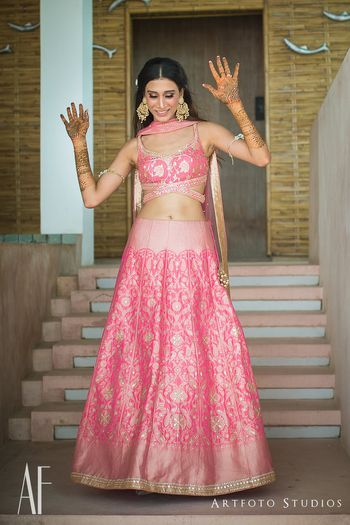 Photo of Benarasi light pink lehenga with unique blouse for mehendi