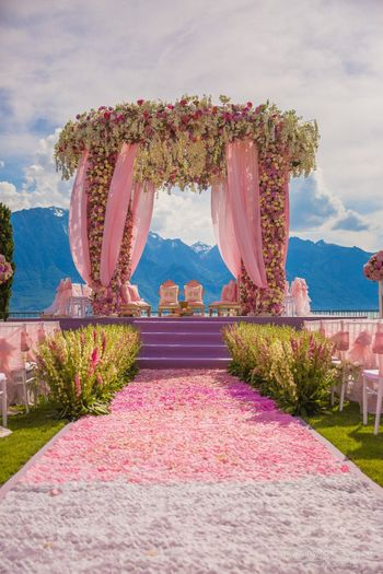 Floral mandap decor with petal aisle