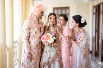 The bride and her family in coordinated floral outfits