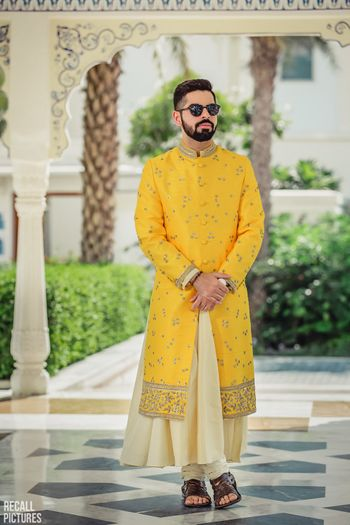 Photo of Offbeat groom in yellow manarkali