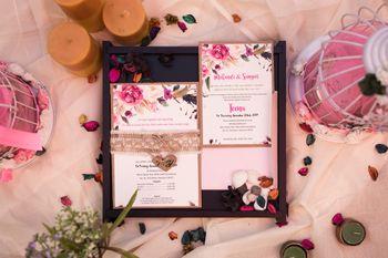 Photo of Pastel wedding card with black box