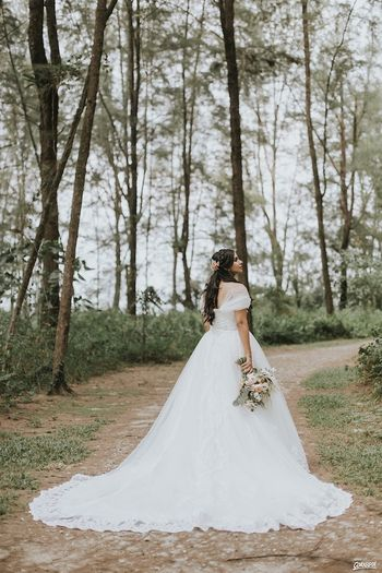 Pretty bride wearing white gown for Christian wedding