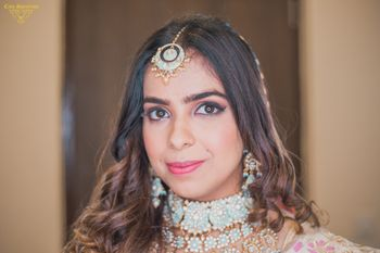 Photo of Contrasting blue pastel jewellery with pink lehenga