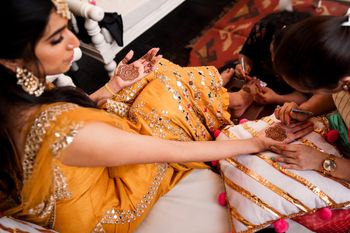 Bride getting her mehendi put.