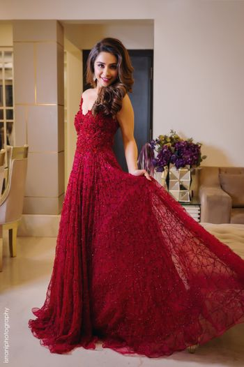 A gorgeous bridal portrait of the bride in a red gown