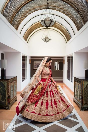 Photo of Maroon and gold bridal lehenga with big butis