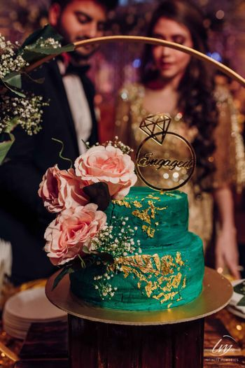 Photo of unique green cake for engagement