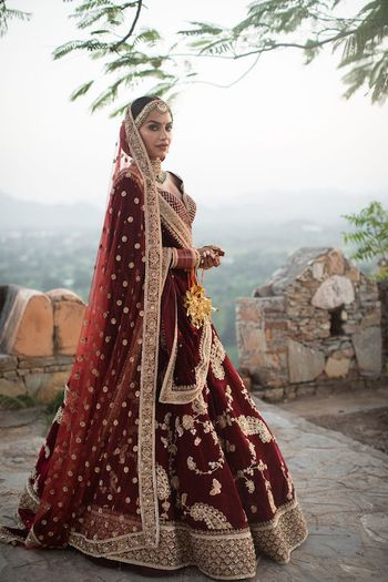 Photo of Maroon sabya bridal lehenga