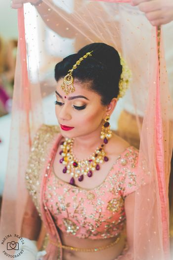 Bride getting ready with dupatta on head