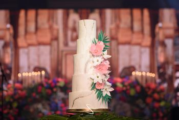 Photo of simple 4 tier floral wedding cake