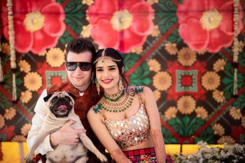Photo of A complete family portrait with the dog, the bride and the groom
