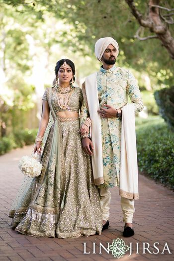 Coordinated bride and groom in pretty outfits