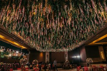Photo of Grand engagement decor idea with floral ceiling