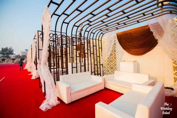 Photo of white lounges for the wedding